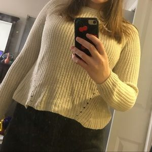 Cream sweater with dot accents down torso